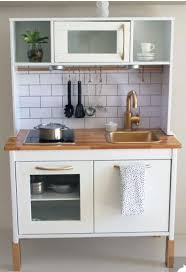 ikea kitchen upgraded with gold paint and subway tiles what
