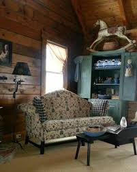 Primitive Living Rooms Pinterest by Colorful Painted Cupboard Gives Beautiful Wood Walls A Pop