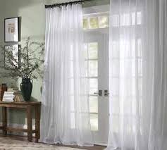 these drapes are beautiful against the sage green walls in this