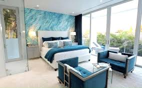 Teal Accent Wall Bedroom With Sitting Area Furniture And Balcony