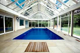 Wonderful Triangle Shaped Skylight With Transparent Concept Above Cool Indoor Swimming Pool