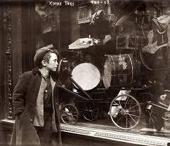 Boy Looking At Xmas Toys In Shop Window
