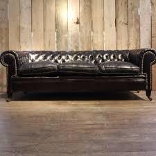 canapé chesterfield cuir noir canapé chesterfield vintage en cuir noir en vente sur pamono