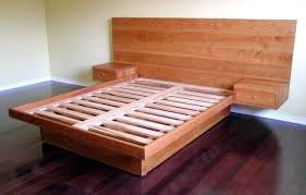 custom platform bed with drawers in sidetables probably wouldn