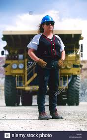 A Female Truck Driver With Her Giant Dump Truck Driver At The Cyprus ...