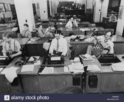 Newsroom Of The New York Times Reporters And Rewrite Men Writing Stories While Others Wait To Be Sent Out Man In Background Gets A Story On