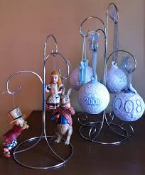 Pretty Groupings Of Collectible Ornaments Multiple Arm Ornament Display Stands Are The Best Way To