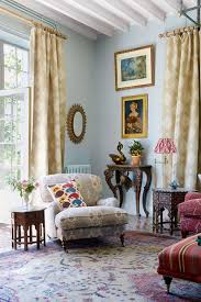 blue living room with comfortable armchair country style living