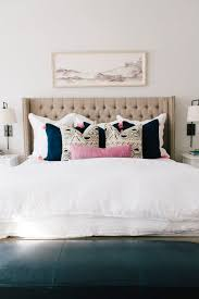 LOVE This Master Bedroom Interior Design With Tufted Headboard Art Above Bed Sconces Tassel Throw Pillows And Pops Of Pink