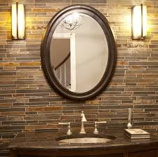 add elegance in your bathroom with oval mirror
