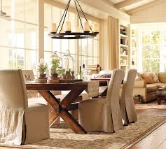 Beige Fabric Dining Chairs Covers With Reclaimed Wood Table Also Antique Metal Round Candle Hanging Lamp