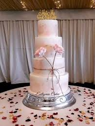 Water Colour Wedding Cake In Shades Of Dusky Pink With Sugar Flowers And Wooden Topper