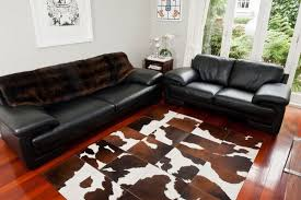 Black Leather Couch Living Room Ideas by Cowhide Rug U2013 The Rustic Charm In Contemporary Decor