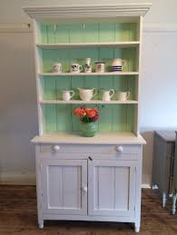 Vintage Two Toned Antique Kitchen Hutch Featuring Lower Crown Molding Door Cabinet Underneath Double Knob Slide