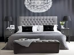 Achromatic Elegant Bedroom Interior Design With Striped Grey Wallpaper And Light Bed Cover Using White Black Pillowcase