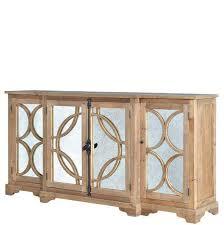 rustikales sideboard aus kiefernholz mit verspiegelten türen in antik optik mit geometrischer verzierung