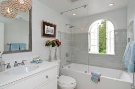 light gray subway tile bathroom traditional with arched window