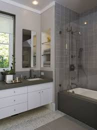 grey wall tile mixed by grey countertop with white cabinet wall