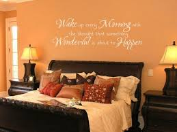 Orange Wall Color With Traditional Wooden Bed Frame And Decorative Decals Quotes For Small Bedroom Design
