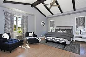 Modern Bedroom Ideas For Men With Unique Vaulted Ceiling Using Grey Colored Bed Linen And Wooden Floor