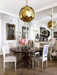 Chic French Dining Room With Modern Chandelier And Traditional Furniture Via Thouswellblog