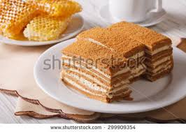 Beautiful Close Up Of Honey Cake On A Plate And Honeycomb Horizontal
