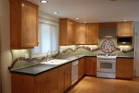 kitchen combined with brown gas range glass mosaic subway