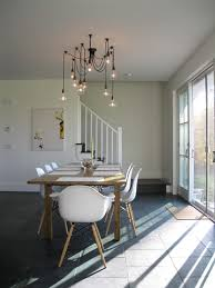 modern dining area with edison bulb chandelier modern dining