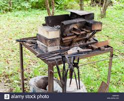 Forge Of Country Outdoor Blacksmith On Backyard Stock Photo ... Henry Warkentins Blacksmith Shop Youtube How To Make A Simple Diy Blacksmiths Forge Picture With Excellent 100 Best Projects To Try Images On Pinterest Classes Backyard On Wonderful Plans For And Dog Danger Emporium L R Wicker Design 586 B C K S M I T H N G Fronnerie Backyards Ergonomic And Brake Drum An Artists Visiting The National Ornamental Metal 1200 Forging Ideas Forge Tongs In Country Outdoor Blacksmith Backyard Stock Photo This Is One Of The Railroad Spike Hatchets Made In My