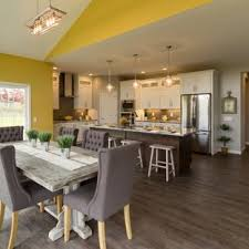 Inspiration For A Large Transitional Medium Tone Wood Floor And Brown Kitchen Dining Room