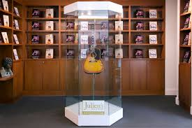 Prestigious American Auction House Juliens Auctions Is Putting John Lennons Gibson J 160E Guitar Up For And Will Display It On The Floating