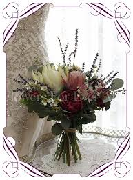 An Elegant Artificial Bridal Bouquet With Silk Protea Burgundy Peony And Lavender Loose Rustic
