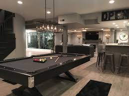 basement pool table ping pong conversion table and dart board