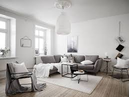 Scandinavian Living Room With Large Pendant Lamp