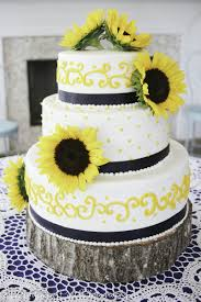 Romantic Rustic Wedding Cake With Pink Flowers Yello Piping Navy And Sunflowers