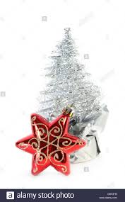 Red Christmas Tree Star And Silver Artificial Made Of Tinsel Grows From Gift Wrapping In Focus