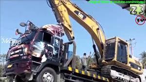 100 Nissan Diesel Trucks Self Loader Loading CAT 336D LME Excavator