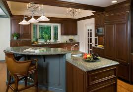 Traditional Cherry Cabinetry In A Kitchen Dining Room With Blue Glazed Cabinets