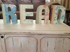 Readers Digest books cut into letters