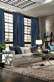 Oversized Drapery Can Make A Room Feel Larger Combine With Pops Of Color To Draw The Eyes From Small Spaces