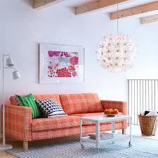 karlstad three seat sofa with husie orange cover and ikea ps 2012