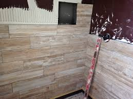 in progress 6x24 porcelain wood plank tile on shower walls tile
