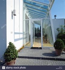100 Glass Extention Extension On Modern White House And View To Hall Stock Photo