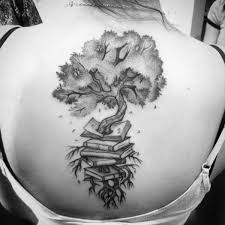 A Tree Grows Out Of Pile Books In This Black Ink Tattoo