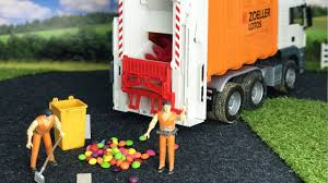 BRUDER TOYS Garbage Truck At Work With Skittles! - YouTube