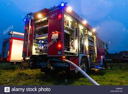 100 Fire Lights For Trucks Truck Or Engine With Flashing Lights Lighting And Hose In Dusk