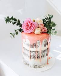 chocolate semi wedding cake with pink drip fresh greenery and flowers
