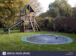 Climbing Frame, Slide And Trampoline In Garden Stock Photo ... Shelley Hughjones Garden Design Underplanted Trampoline The Backyard Site Everything A Can Offer Pics On Awesome In Ground Trampoline Taylormade Landscapes Vuly Trampolines Fun Zone 3 Games For The Family Active Blog Wonderful Diy Recycled Chicken Coops Interesting Small Images Decoration Best Whats Reviews Ratings Playworld Omaha Lincoln Nebraska Alleyoop Kids Jump And Play On In Backyard Stock Video How To Buy A Without Killing Your Homeowners Insurance