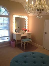 classic bedroom design with corner lighted mirror dressing table