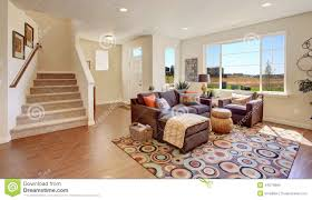 Brown Couch Living Room Ideas by Living Room With Brown Couch And Cheerful Rug Stock Photo Image